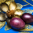 Easter eggs with golden flower — Stock Photo