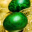 Easter egg with golden leaves - Stockfoto