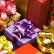 Stock Photo: Red, violet, golden gift boxes