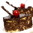 Stock Photo: Chocolate cakes with red cherry