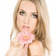 Tender girl with pink flower — Stock Photo