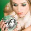 Beautiful girl with silver ball - Stok fotoğraf