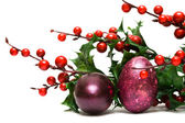 Easter egg with red berries — Stock Photo
