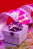 Violet gift box with ribbon — Stock Photo