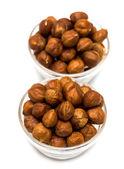 Many hazelnuts in glass bowls — Stock Photo