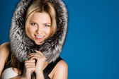 Pretty girl with fur on head — Stock Photo