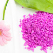 Stock Photo: Spa essentials (bath salt and flower)