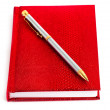 Red notebook with silver pen — Stock Photo #3579326