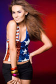 American woman in colored background — Stock Photo