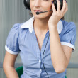 Girl commentator with headset on the tribune - Stock Photo