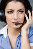 Girl commentator with headset on the tribune — Stock Photo