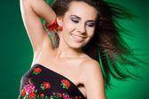 Beautiful woman on green background — Stock Photo