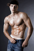 Young bodybuilder man on black background — Fotografia Stock
