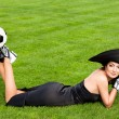 Elegant woman with Football ball - Stock Photo