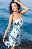 Beautiful woman near the sea — Stock Photo