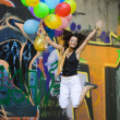 Happy woman with colorful balloons - Stockfoto