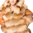 Beautiful woman in a fur coat — Stockfoto