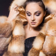 Beautiful woman in a fur coat — Stock Photo #3637982