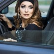 Stock Photo: Beautiful woman in a car