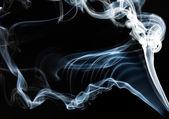 Fumaça sobre fundo preto azul — Foto Stock