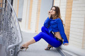 Beautiful woman in blue suit — Stock Photo
