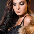 Stock Photo: Beautiful fashionable woman with fur