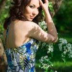 Tender girl in the garden with flowerings trees — Stock Photo #3903059