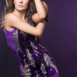 Fashionable woman in violet dress — Stock Photo
