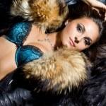 Beautiful fashionable woman with fur — Stock Photo