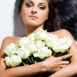 Beautiful fashionable woman with long hair and roses — Stock Photo #3904108