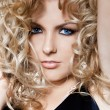 Beautiful fashionable womwith curls — Stock Photo #3904176
