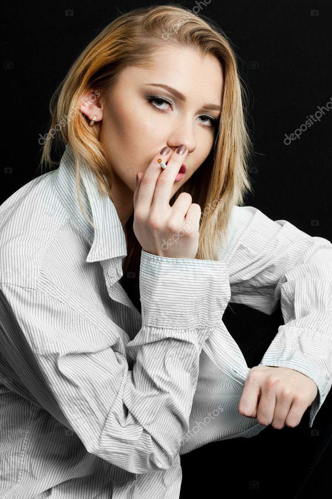 Beautiful woman smokes a cigarette — Stock Photo #3902554