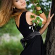 Beautiful woman near the tree — Stock Photo