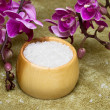 Spa essentials (bath salt in a bowl and flowers of orchids) - Stock Photo