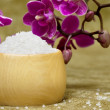 Stock Photo: Spa essentials (bath salt in a bowl and flowers of orchids)