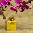 Gift box with purple orchid — Stock Photo #3912900
