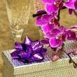 Gift box with purple orchid — Stock Photo #3912901