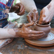 Potters hands with pot — Stock Photo