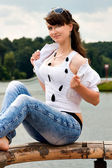 Smile teen sitting in spring park — Stock Photo