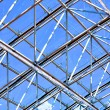 Abstract blue geometric ceiling in office center — Stock Photo
