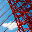 Stock Photo: Vivid red suspension bridge