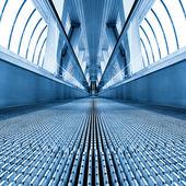 Moving escalator in square composition — Stock Photo
