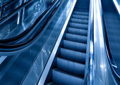 Diminishing stairway of blue empty business esca — Stock Photo
