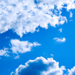 Blue sky background with white clouds - Photo
