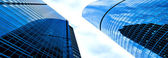 Panoramic sight of modern geometric skyscrapers — Stock Photo