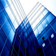 Blue glass transparent wall of modern bulding house - Stock Photo