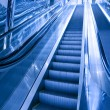 Moving escalator in airport — Foto de Stock