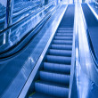 Moving escalator in airport — Stock Photo
