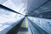 Fast moving escalator by motion — Stockfoto