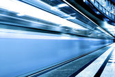 Fast moving train by motion — Stock Photo